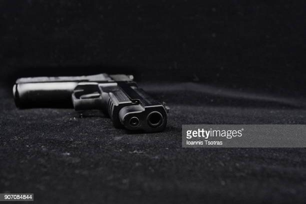 a black pistol  (gun) - shooting crime stock pictures, royalty-free photos & images