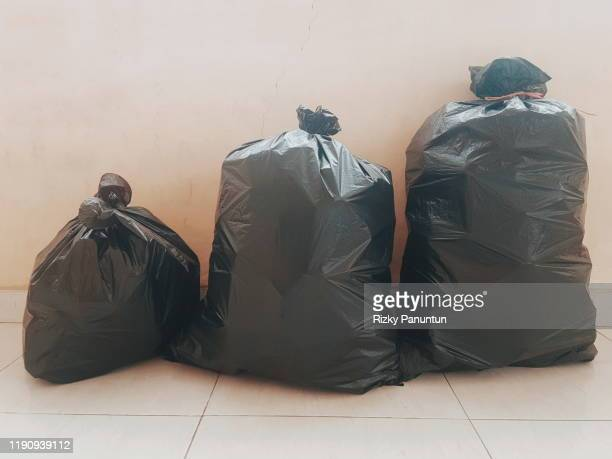 black plastic garbage bags - ゴミ袋 ストックフォトと画像