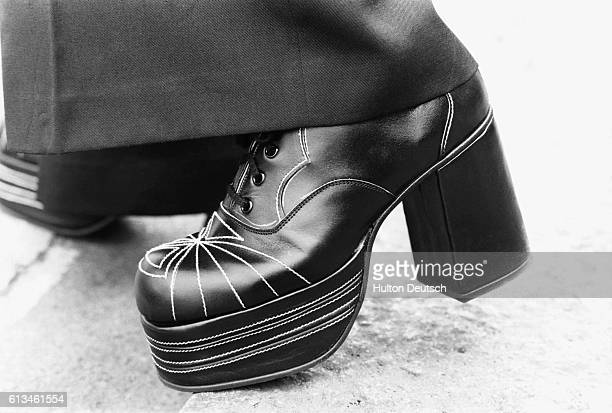 Black platforms with white stitching. London, ca. 1975.