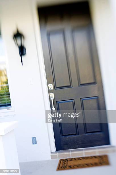 black porch light and door of white house - dana white stock pictures, royalty-free photos & images