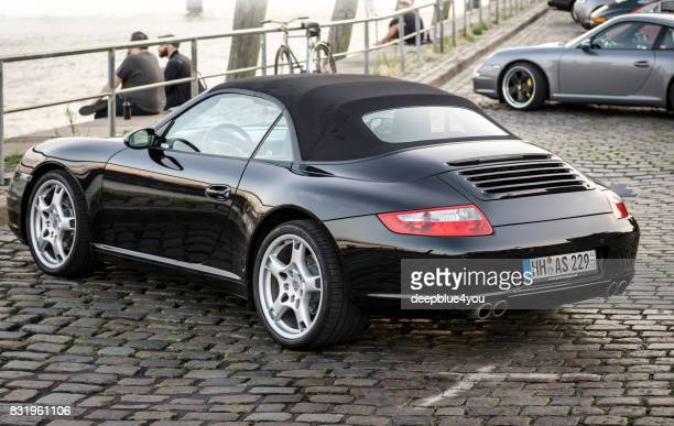 Black Porsche 911 cabriolet parked during the event with Magnus Walker on the Fish Market Hamburg