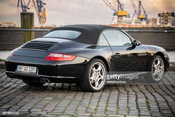 Schwarz Porsche 911 Cabriolet mit Magnus Walker am Hamburger Markt Fisch während der Veranstaltung abgestellt