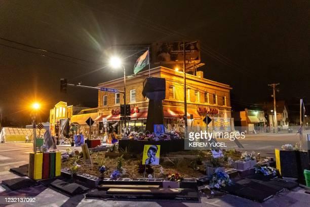 "Black Power fist statue, flag and flowers adorn ""George Floyd Square"", April 5, 2021 in Minneapolis, Minnesota. - Minneapolis police chief Medaria..."