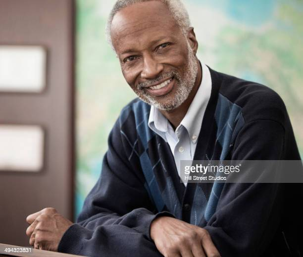 Black professor smiling in classroom