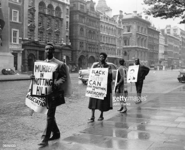 Black protesters demonstrating in Whitehall against the outbreak of racist violence in Notting Hill Gate, London.