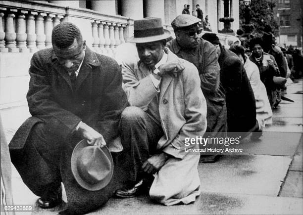 Black Protesters Kneeling Before City Hall, Birmingham, Alabama, USA, Minutes Before Being Arrested for Parading Without a Permit, April 6, 1963.