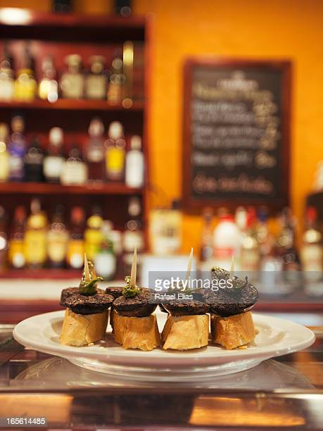black pudding tapas - tapas stock photos and pictures