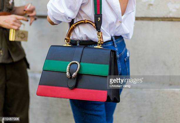 A black red green Gucci bag outside Marni during Milan Fashion Week Spring/Summer 2017 on September 25 2016 in Milan Italy
