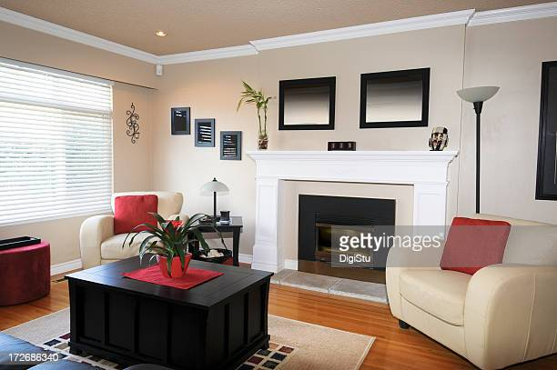 Black, red, ivory modern living room with fireplace