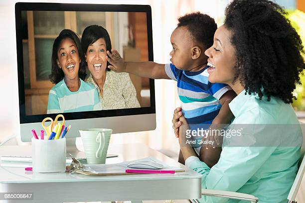 Black relatives chatting via video conference