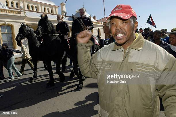 Black resident of Potchefstroom is seen as part of a crowd that gathered to see Eugene Terreblanche , former leader of the neo-nazi Afrikaner...