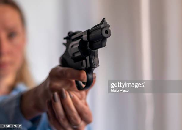 black revolver - gun stock pictures, royalty-free photos & images