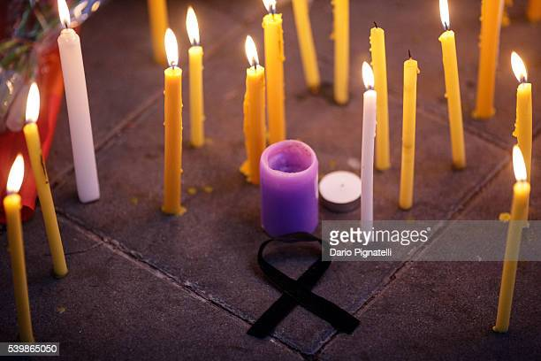 A black ribbon sits on the floor amidst candles during a vigil for the attack at the gay club in Orlando on Monday June 13 in Bangkok Thailand