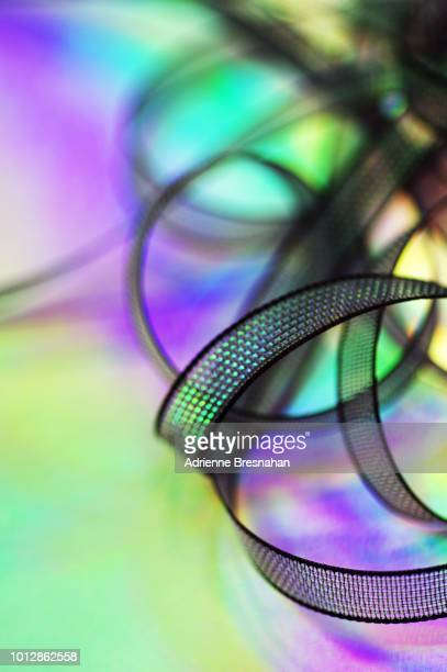 Black Ribbons on Holographic Background