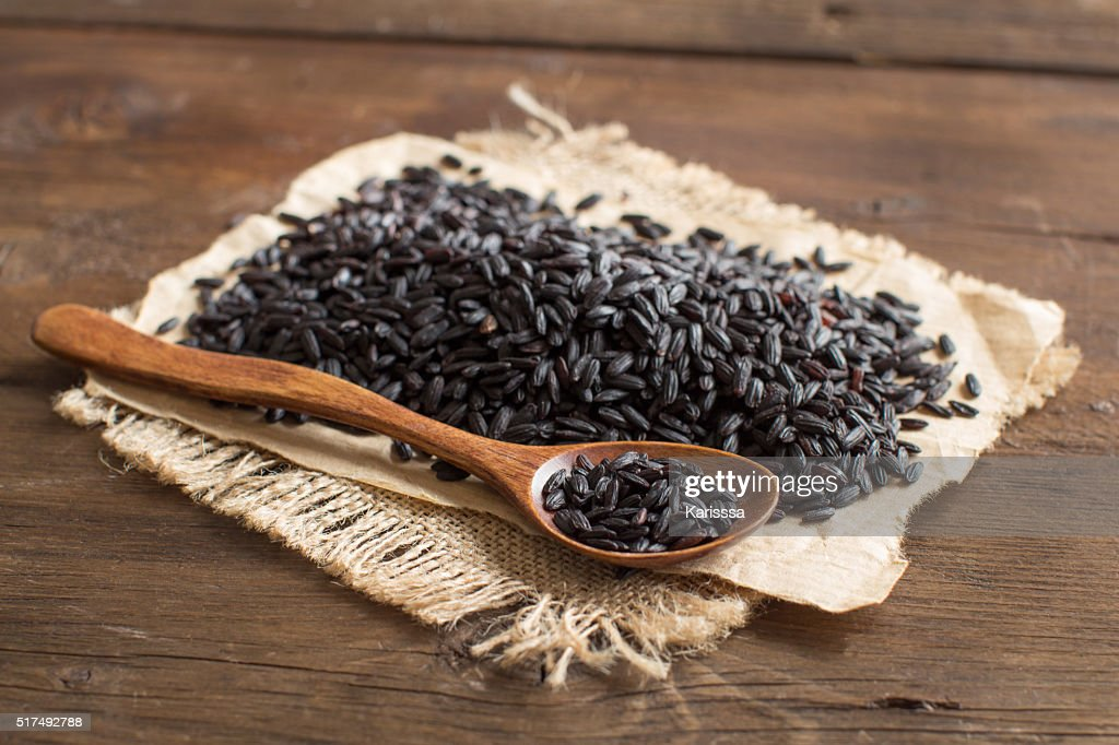 Black rice with a spoon : Stock Photo