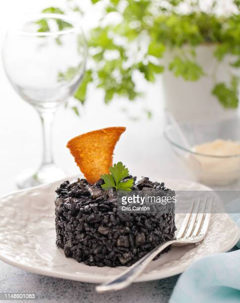 black rice with calamari - black rice stock pictures, royalty-free photos & images