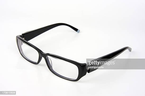 black rimmed spectacles - thick rimmed spectacles stock photos and pictures