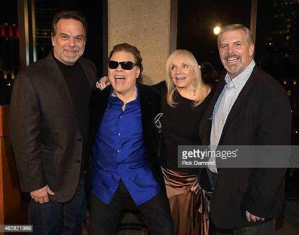 Black River Entertainments Doug Johnson and Gordon Kerr with Ronnie Milsap and Joyce Milsap attend Ronnie Milsap Exhibit Opening Reception At The...