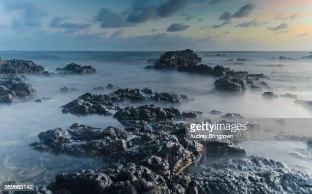 black rocks - french overseas territory stock pictures, royalty-free photos & images