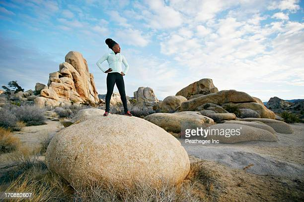 black runner in desert landscape, joshua tree national park, california, united states - hand on hip stock pictures, royalty-free photos & images