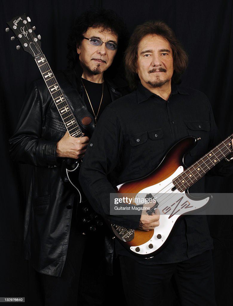 Black Sabbath guitarist's Toni Iommi (L) with his Gibson Custom Shop SG and Geezer Butler with his custom Lakland Skyline bass guitar taken on June 12, 2007.