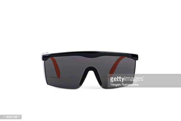 black safety glasses personal protective equipment on white background - sunglasses stock pictures, royalty-free photos & images
