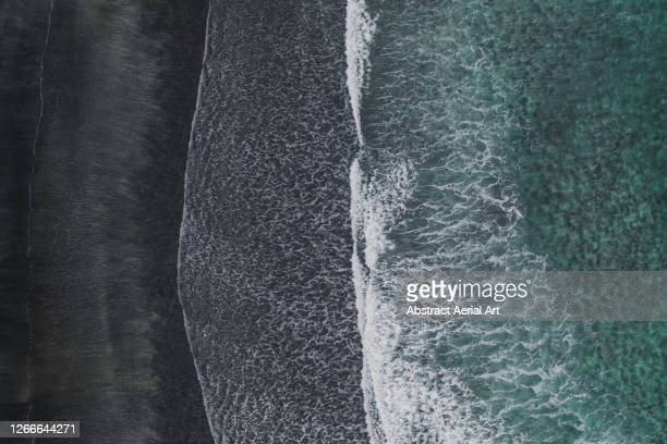 black sand beach and the atlantic ocean photographed by drone, isle of skye, scotland, united kingdom - wave stock pictures, royalty-free photos & images