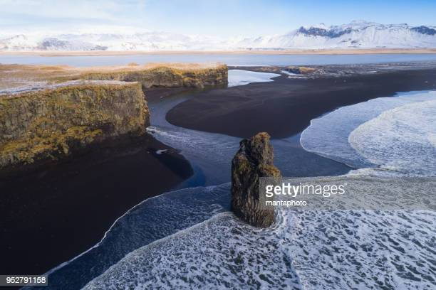 black sand beach in vik, iceland - iceland stock pictures, royalty-free photos & images