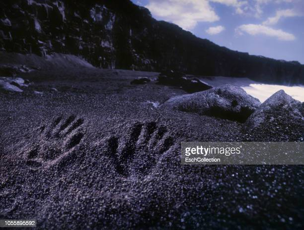 Black sand beach with hand imprints, Big Island, Hawaii
