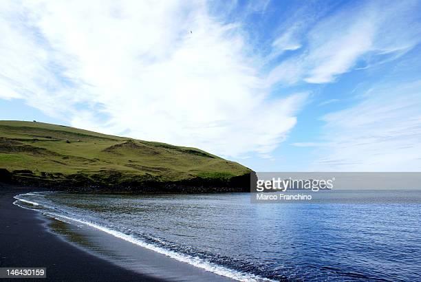 Black sand, blue sky