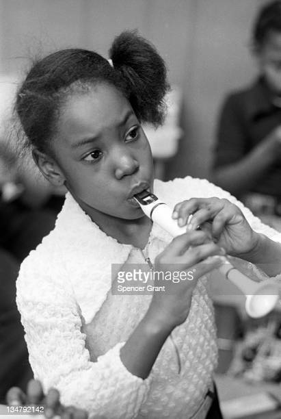 Black schoolchildren play recorders, Roxbury, Boston, Massachusetts, 1971.
