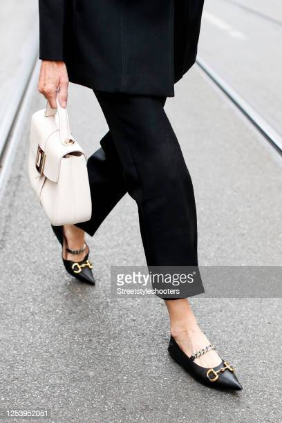 Black shoes by Gucci and a white bag by Roger Vivier as a detail of Annette Weber during a street style shooting on June 30, 2020 in Munich, Germany.