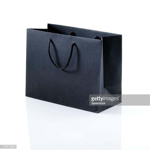 preto bolsa de compras sobre branco - bolsa preta - fotografias e filmes do acervo