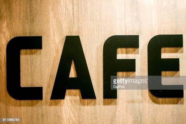"black sign on wood wall ""cafe"" - lettre a photos et images de collection"