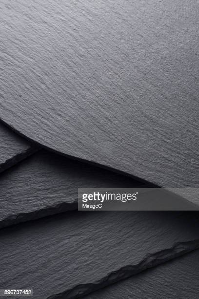black slate boards stacking - slate rock stock photos and pictures