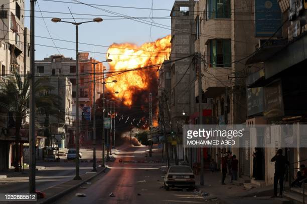 Black smoke billows after an Israeli airstrike on Gaza City targeted the Intaj Bank linked to the Hamas movement which controls the Gaza Strip on May...