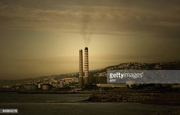 Black smoke billows from the chimney of a fuel oil power generating plant in the Lebanese coastal town of Zouk Michael north of Beirut on December 15...