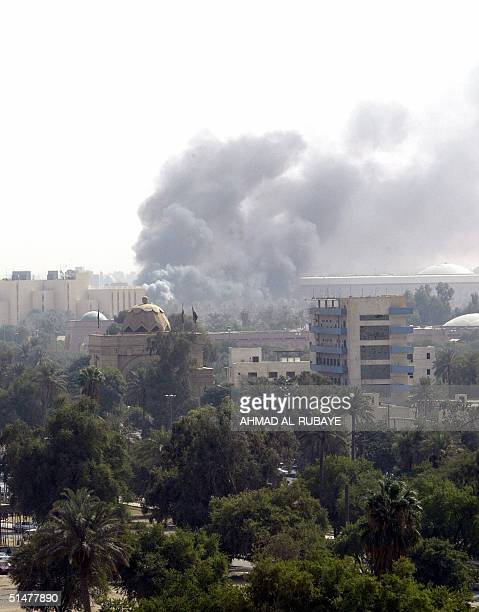Black smoke billows from the Green Zone following two explosions 14 October 2004 in central Baghdad The Green Zone which houses the US and the...