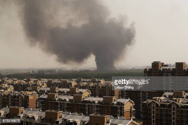 Black smoke billows into the air near Crab Island Resort on May 1 2017 in Beijing China Beijing Crab Island Resort has been evacuated after a large...