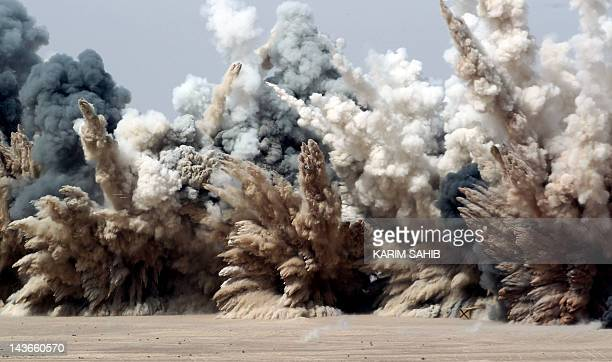 Black smoke dust and sand rise after UAE F16 fighter jets fired missiles during joint manoeuvres with the French army in the desert of Abu Dhabi May...