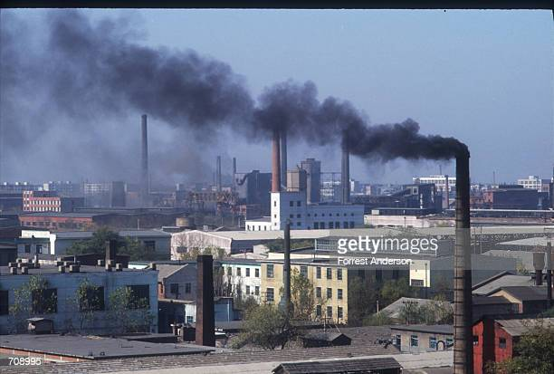 Black smoke emerges from a coal factorys chimney November 12, 1990 in Beijing, China. Beijings mounting levels of carbon monoxide, continued coal...