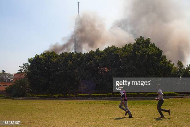 Black smoke files from the Police club in Cairo Egypt on Saturday March 9 after being attacked by members of the Ultras AlAhly football club...
