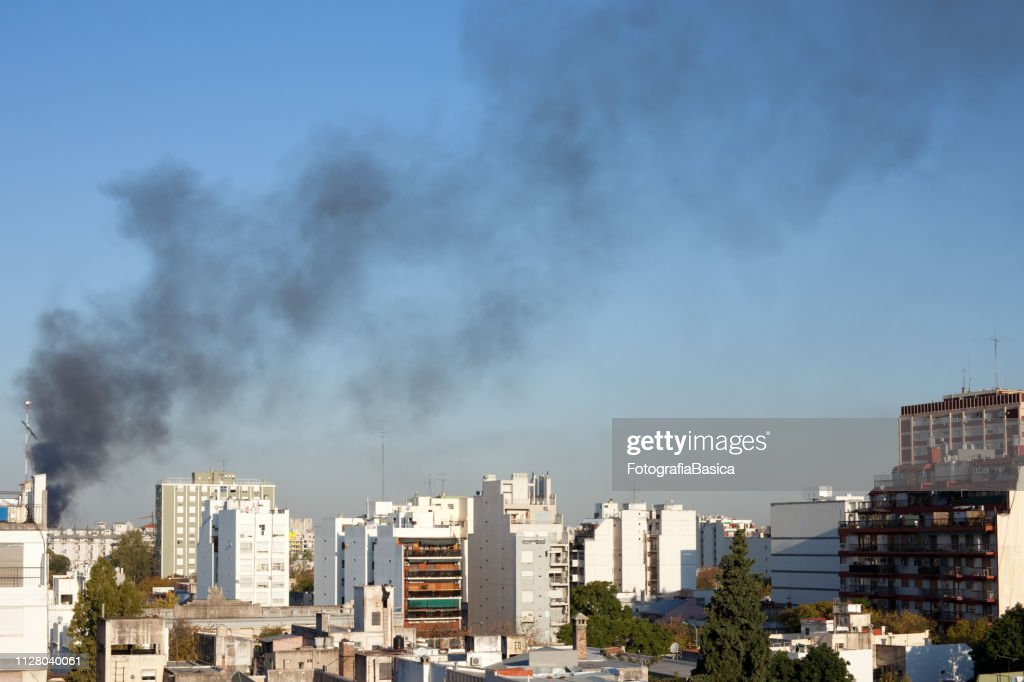 Black smoke in the sky : Stock Photo