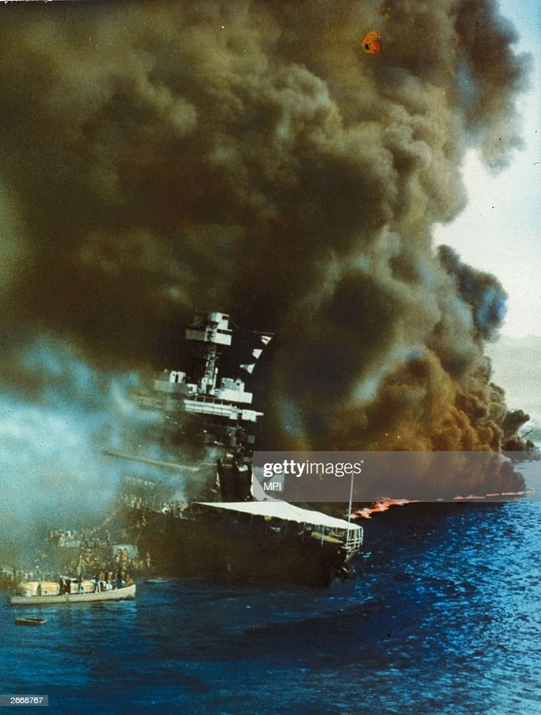 Black smoke pouring from USS California on fire in Pearl Harbour (Pearl Harbor), Oahu Island after the surprise attack by the Japanese which brought America into WW II.