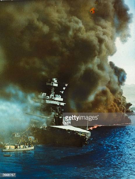 Black smoke pouring from USS California on fire in Pearl Harbour Oahu Island after the surprise attack by the Japanese which brought America into WW...