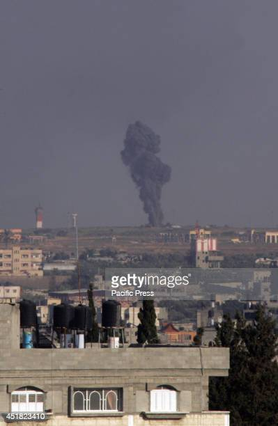 Black smoke rises following an Israeli air strike on the Gaza International Airport in Rafah. Israeli air strikes on Gaza killed eight Palestinian...