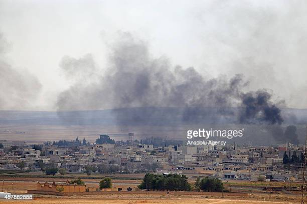 Black smoke rising from Kobani town of northern Syria during the intensified clashes between Islamic State of Iraq and Levant members and Kurdish...