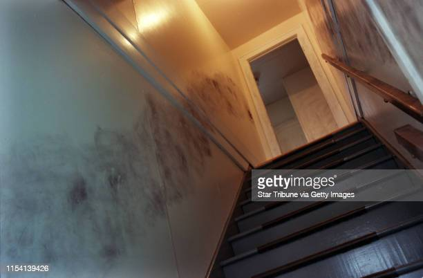 Black smudges remans on the walls along the stairs leading to Connie Sarffs second floor apartment after authorities dusted them for finger prints...