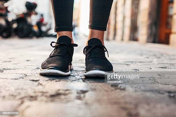 black sneakers of sportive young woman, close-up - black shoe stock pictures, royalty-free photos & images