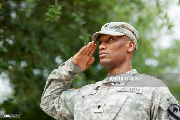 black soldier saluting - army soldier stock pictures, royalty-free photos & images